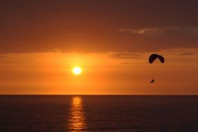Paratrooper sunset sun sea view