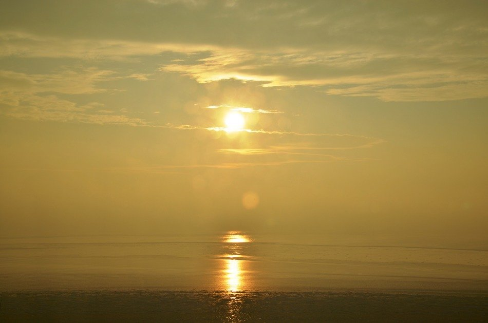 Foggy sunset on Baltic Sea