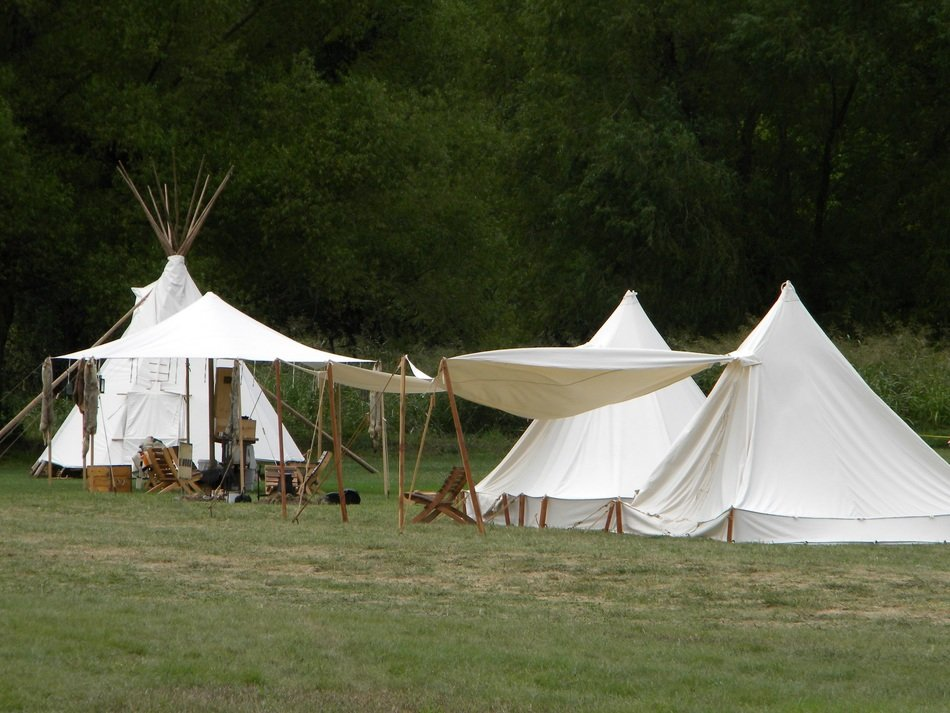 camp with white tents in nature