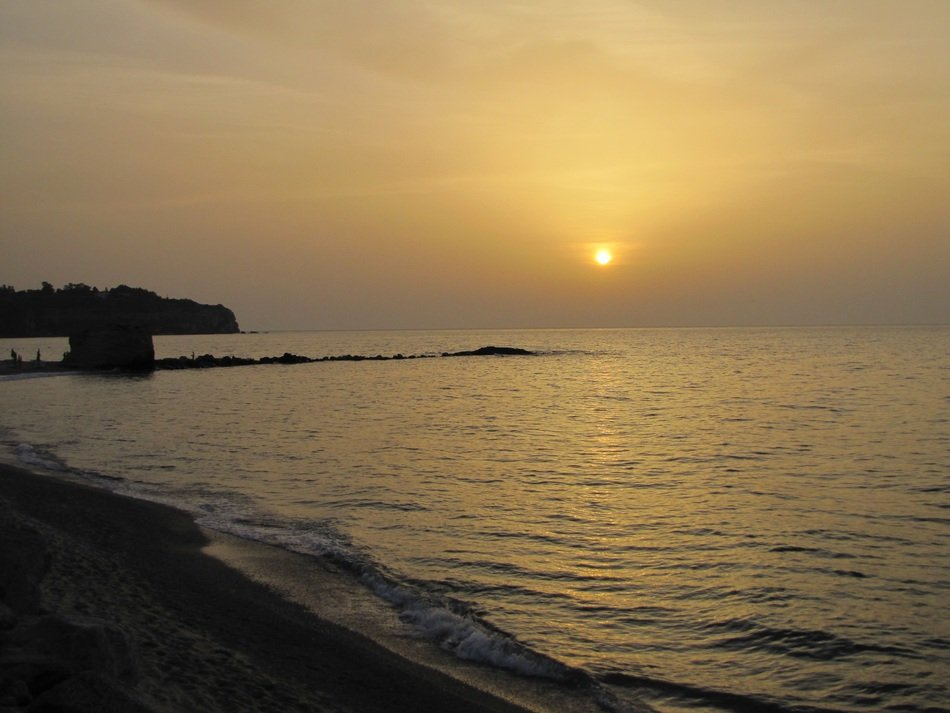 yellow setting sun over the coast of Calabria
