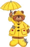 painted teddy bear in yellow clothes with a yellow umbrella