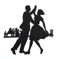 black silhouette of a dancing couple on stage