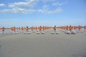 parasols and sun lounger on a beach