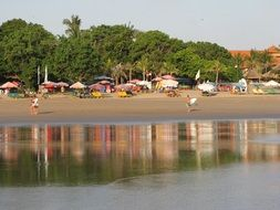 sandy beach with people, indonesia