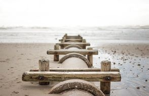 wooden fence on the beach