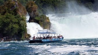 boat with people near the Rhine Falls