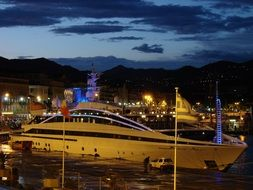 luxury megayacht in the port in the evening