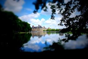 distant view of a palace near a lake in france