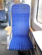 blue seat by the window in the train
