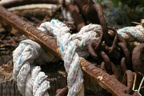 Rusty anchor, chain and rope