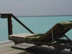 green towel on a lounger on the Indian Ocean
