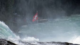 flag of switzerland near the rhine falls