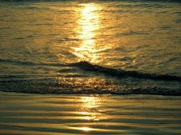 sunset reflection on ocean surface