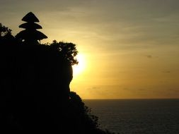 rocky coast of bali at sunset