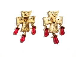 gold cross shaped earrings with red stones