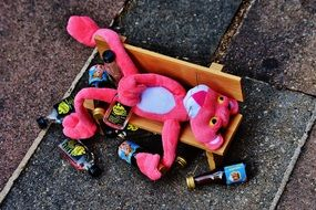 pink panther on a bench with bottles
