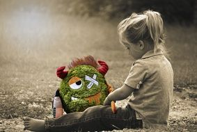 Little Girl and monster toy