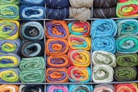 lot of multi-colored wool for knitting