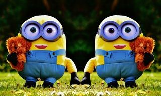 plush minions on green grass
