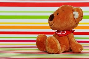 soft toy on a bright striped surface