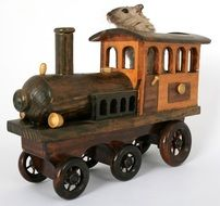 mouse in a wooden toytrain