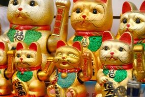 golden cats like lucky charm in japan