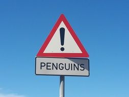 Penguins, warning traffic sign at sky, South Africa, cape point