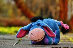 soft toy of blue color in the form of a donkey
