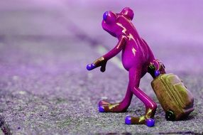 frog farewell travel luggage statue