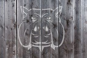 drawing a dog on a wooden fence