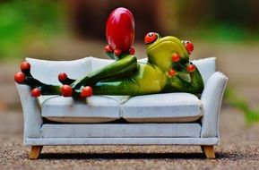funny figure of a frog on the sofa