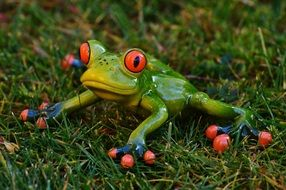 funny figure of a frog on green grass