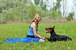 Doberman dog and woman