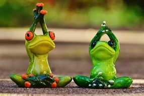 figures of meditating frogs