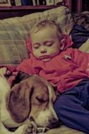 Baby and Beagle Dog Sleeping