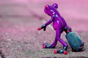 cute frog with luggage