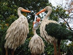 Storks and baby garden sculpture