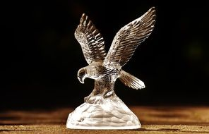 a bird of prey from a glass