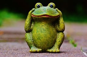 funny figure of a cute frog