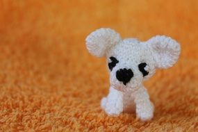 Cute puppy toy on the carpet
