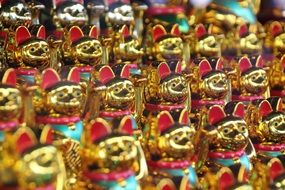 golden figures of waving cats