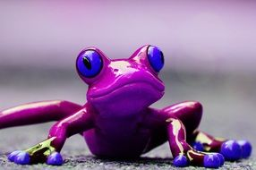 ceramic figure of an exotic purple frog