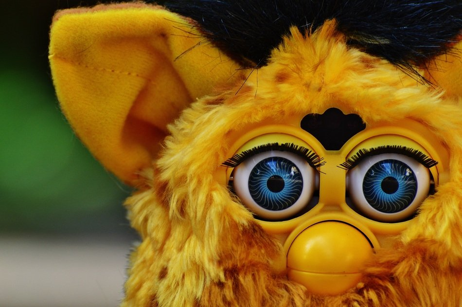 yellow furby with blue eyes
