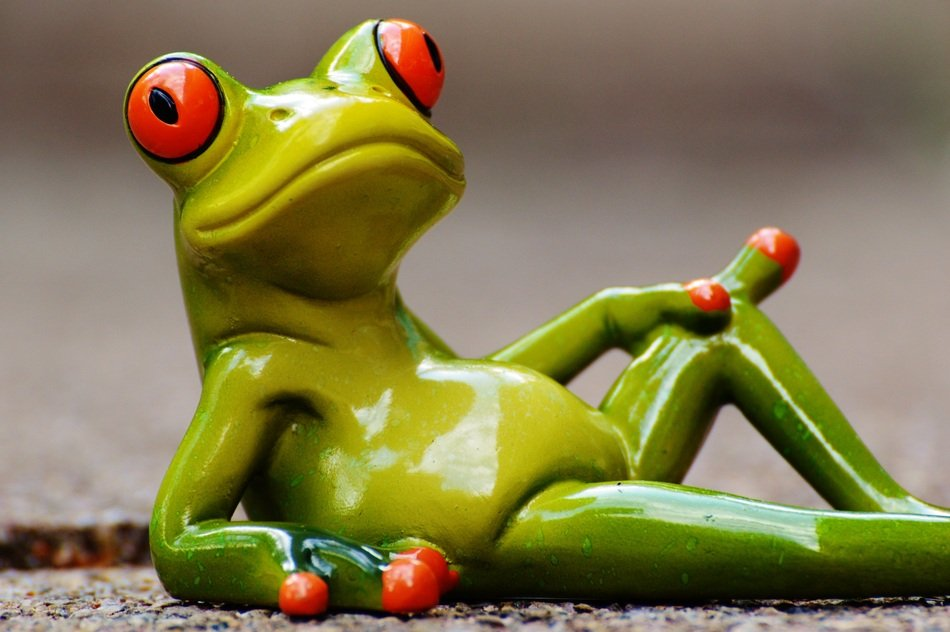 ceramic figure of a relaxed frog