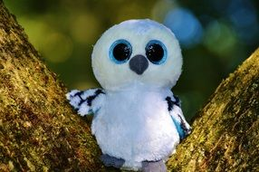 soft toy of snowy owl on the tree