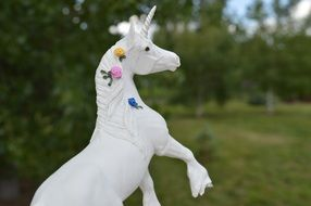 white unicorn toy in colors