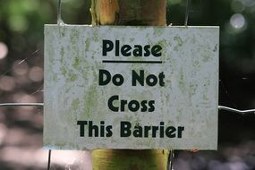 picture of the please do not cross this barrier sign