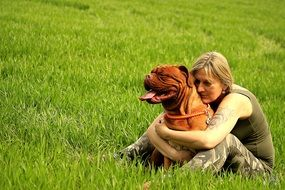 owner hugging his french mastiff
