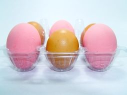 pink and yellow eggs on a stand