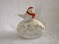 Christmas figurine with a little bird